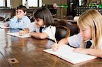 Children writing Stock Photo - Premium Royalty-Free, Artist: Westend61, Code: 6114-06609206