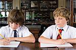 Boys working Stock Photo - Premium Royalty-Free, Artist: Westend61, Code: 6114-06609212
