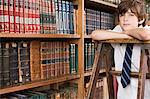 Boy in a library Stock Photo - Premium Royalty-Free, Artist: Blend Images, Code: 6114-06609214
