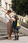 Girl and mother outside school Stock Photo - Premium Royalty-Freenull, Code: 6114-06609220