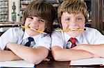 School friends biting pencils Stock Photo - Premium Royalty-Free, Artist: Blend Images, Code: 6114-06609221