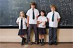 Children in front of blackboard Stock Photo - Premium Royalty-Free, Artist: Blend Images, Code: 6114-06609224