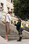 Girl and mother outside school Stock Photo - Premium Royalty-Freenull, Code: 6114-06609231