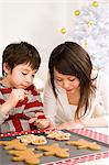 Mother and son icing gingerbread men Stock Photo - Premium Royalty-Free, Artist: Blend Images, Code: 6114-06609242