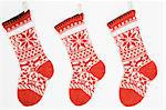 Christmas stockings in a row Stock Photo - Premium Royalty-Freenull, Code: 6114-06609246