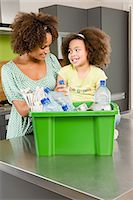 entry field - Mother and daughter recycling Stock Photo - Premium Royalty-Freenull, Code: 6114-06609500