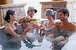 Friends having wine in hot tub Stock Photo - Premium Royalty-Free, Artist: Aflo Relax, Code: 6114-06609658