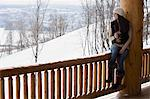 Woman looking at winter view Stock Photo - Premium Royalty-Free, Artist: Blend Images, Code: 6114-06609660