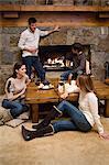 Friends relaxing in a chalet Stock Photo - Premium Royalty-Free, Artist: ClassicStock, Code: 6114-06609672