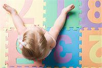 Baby girl sitting Stock Photo - Premium Royalty-Freenull, Code: 6114-06609729