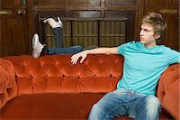 Young couple behind sofa Stock Photo - Premium Royalty-Freenull, Code: 6114-06609821