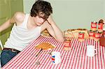 Tired teenager at table Stock Photo - Premium Royalty-Free, Artist: oliv, Code: 6114-06609831