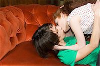 Teenagers kissing on a sofa Stock Photo - Premium Royalty-Freenull, Code: 6114-06609843