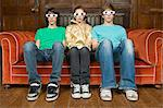 Three teenagers wearing 3d glasses Stock Photo - Premium Royalty-Free, Artist: Westend61, Code: 6114-06609848