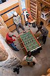 Young men playing table football Stock Photo - Premium Royalty-Free, Artist: Cultura RM, Code: 6114-06609872