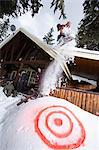 Man snowboarding off chalet roof Stock Photo - Premium Royalty-Free, Artist: Aflo Sport, Code: 6114-06609884