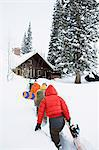Snowboarders returning to chalet Stock Photo - Premium Royalty-Free, Artist: Raimund Linke, Code: 6114-06609889