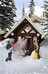 Snowboarders outdside chalet Stock Photo - Premium Royalty-Free, Artist: CulturaRM, Code: 6114-06609892