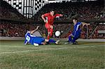 Opposite players tackling footballer Stock Photo - Premium Royalty-Free, Artist: Aflo Sport, Code: 6114-06609911