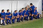 Footballer celebrating with team mates Stock Photo - Premium Royalty-Free, Artist: photo division, Code: 6114-06609919