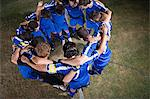 Football team in a huddle Stock Photo - Premium Royalty-Free, Artist: Cultura RM, Code: 6114-06609925