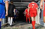 Footballers walking into tunnel Stock Photo - Premium Royalty-Free, Artist: AWL Images, Code: 6114-06609926
