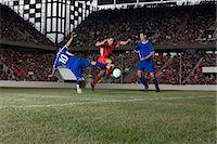 footballeur - Opposite players tackling footballer Stock Photo - Premium Royalty-Freenull, Code: 6114-06609931