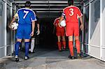 Footballers walking into tunnel Stock Photo - Premium Royalty-Free, Artist: Minden Pictures, Code: 6114-06609940