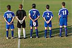 Football team in a row Stock Photo - Premium Royalty-Free, Artist: Westend61, Code: 6114-06609944