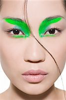Woman with bright green eyeshadow Stock Photo - Premium Royalty-Freenull, Code: 6114-06609955
