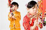 Children blowing on pinwheels Stock Photo - Premium Royalty-Free, Artist: Westend61, Code: 6114-06610020