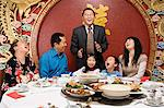 Family at reunion dinner Stock Photo - Premium Royalty-Free, Artist: Blend Images, Code: 6114-06610043
