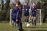 Boy taking a free kick Stock Photo - Premium Royalty-Free, Artist: Robert Harding Images, Code: 6114-06610050