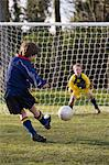 Boy kicking a football Stock Photo - Premium Royalty-Free, Artist: CulturaRM, Code: 6114-06610068