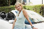 Woman leaning on convertible Stock Photo - Premium Royalty-Free, Artist: Zoomstock, Code: 6114-06610147