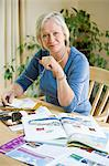 Woman with holiday brochures Stock Photo - Premium Royalty-Freenull, Code: 6114-06610156