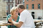 Woman giving gift to husband Stock Photo - Premium Royalty-Free, Artist: Blend Images, Code: 6114-06610190