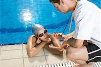 stop watch - Swimmer and coach Stock Photo - Premium Royalty-Freenull, Code: 6114-06610235