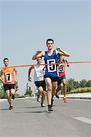finish line - Runners reaching finish line Stock Photo - Premium Royalty-Freenull, Code: 6114-06610248