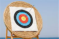 Arrow in archery target Stock Photo - Premium Royalty-Freenull, Code: 6114-06610258