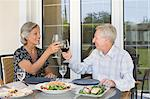 Couple toasting Stock Photo - Premium Royalty-Free, Artist: Blend Images, Code: 6114-06610265