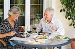 Couple dining al fresco Stock Photo - Premium Royalty-Free, Artist: Blend Images, Code: 6114-06610282