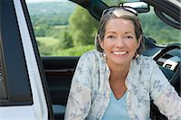 Woman in a car Stock Photo - Premium Royalty-Freenull, Code: 6114-06610324