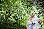 Couple in a forest Stock Photo - Premium Royalty-Free, Artist: Cultura RM, Code: 6114-06610342