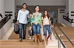 Family walking down stairway Stock Photo - Premium Royalty-Free, Artist: CulturaRM, Code: 6114-06610479