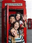 Tourists in a red telephone booth Stock Photo - Premium Royalty-Free, Artist: ableimages, Code: 6114-06610532