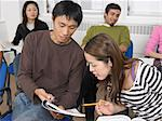 Students helping each other Stock Photo - Premium Royalty-Free, Artist: Cultura RM, Code: 6114-06610565