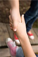 A helping hand Stock Photo - Premium Royalty-Freenull, Code: 6114-06610607