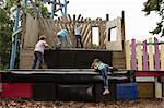 Children on a climbing frame Stock Photo - Premium Royalty-Free, Artist: GreatStock, Code: 6114-06610615