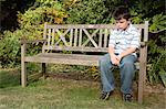 Sullen boy on a bench Stock Photo - Premium Royalty-Free, Artist: CulturaRM, Code: 6114-06610618